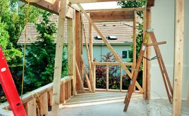 ladders on a porch during a home renovation